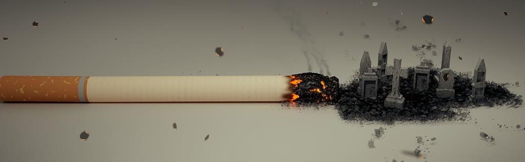 Nikotinsucht bekämpfen - glühende Zigarette auf dem Tisch